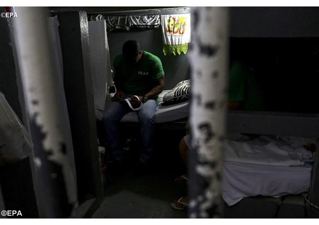 Detento em prisão no Brasil - EPA